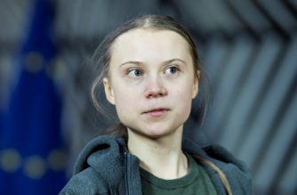 (FILES) In this file photo taken on March 5, 2020 Swedish environmentalist Greta Thunberg arrives for a meeting with EU environment ministers at the Europa Building in Brussels. - Swedish climate activist Greta Thunberg has donated a $100,000 prize she won from a Danish foundation to the United Nations Children's Fund (UNICEF) for use against the COVID-19 pandemic, the world body said on April 30, 2020. (Photo by Kenzo TRIBOUILLARD / AFP)