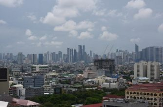 A general view of the skyline in Manila taken around 11:00 am shows clear skies on May 15, 2020, as Typhoon Vongfong is expected to brush past the capital city. - Typhoon Vongfong flattened flimsy coastal homes when it roared ashore on central Samar island on May 14, but then weakened into a severe tropical storm on its path north to the capital Manila. (Photo by Ted ALJIBE / AFP)