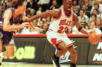 "(FILES) In this file photo taken on June 4, 1997 former Chicago Bulls player Michael Jordan sticks out his tongue as he goes past Jeff Hornacek of the Utah Jazz during game two of the NBA Finals at the United Center in Chicago, IL. - Michael Jordan believes the Chicago Bulls 1990s NBA dynasty would have stayed together for at least one more season if team chiefs had backed coach Phil Jackson.  The retired legend made his comments in the last chapter of hit documentary ""The Last Dance"", saying he would have re-signed a one-year deal had management kept the team together, including Dennis Rodman, Scottie Pippen and Jackson. (Photo by VINCENT LAFORET / AFP)"