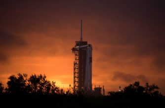 """This handout photo released by NASA shows a SpaceX Falcon 9 rocket with the company's Crew Dragon spacecraft onboard on the launch pad at Launch Complex 39A as preparations continue for the Demo-2 mission, May 25, 2020, at NASA's Kennedy Space Center in Florida. - NASA's SpaceX Demo-2 mission is the first launch with astronauts of the SpaceX Crew Dragon spacecraft and Falcon 9 rocket to the International Space Station as part of the agency's Commercial Crew Program. The test flight serves as an end-to-end demonstration of SpaceX's crew transportation system. Robert Behnken and Douglas Hurley are scheduled to launch at 4:33 p.m. EDT on Wednesday, May 27, from Launch Complex 39A at the Kennedy Space Center. (Photo by Bill INGALLS / NASA / AFP) / RESTRICTED TO EDITORIAL USE - MANDATORY CREDIT """"AFP PHOTO / NASA / BILL INGALLS """" - NO MARKETING - NO ADVERTISING CAMPAIGNS - DISTRIBUTED AS A SERVICE TO CLIENTS"""