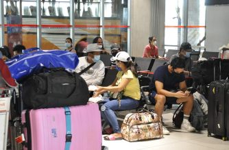 OFWs wait at the PITX during the Hatid-Probinsya operations of the OWWA, DOTr, and Philippine Coast Guard on May 26.  The Department of Labor and Employment (DOLE) said that nearly 100,000 OFWs remain stranded in various countries worldwide as of Friday, May 29. (Photo Courtesy: OWWA)