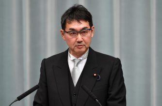 Newly appointed Japanese Justice Minister Katsuyuki Kawai speaks during a press conference at the prime minister's official residence in Tokyo on September 11, 2019. - Japan's Prime Minister Shinzo Abe on September 11 appointed new foreign and defence ministers and promoted a popular rising political star, in a cabinet reshuffle that fuelled speculation over the prime minister's successor. (Photo by Toshifumi KITAMURA / AFP)