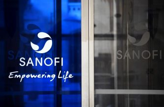 A photograph taken on March 27, 2020 shows a  Sanofi's logo at the headquarters in Paris, during a strict lockdown in France aimed at curbing the spread of the COVID-19 infection, caused by the novel coronavirus. (Photo by FRANCK FIFE / AFP)