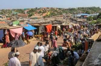 "Rohingya refugees gather at a market as first cases of COVID-19 coronavirus have emerged in the area, in Kutupalong refugee camp in Ukhia on May 15, 2020. - Emergency teams raced on May 15 to prevent a coronavirus ""nightmare"" in the world's largest refugee settlement after the first confirmed cases in a sprawling city of shacks housing nearly a million Rohingya. (Photo by Suzauddin RUBEL / AFP)"