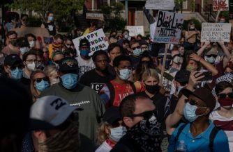 Protesters march against police brutality and in memory of George Floyd in Detroit, Michigan, on June 7, 2020. - Protesters have rallied for racial justice in cities across the United States following the death of George Floyd at the hands of police on May 25. (Photo by SETH HERALD / AFP)