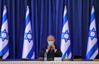 Israeli Prime Minister Benjamin Netanyahu, wearing a protective face mask, chairs the weekly cabinet meeting in Jerusalem on June 21, 2020. (Photo by ABIR SULTAN / POOL / AFP)