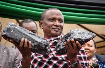 Tanzanian small-scale miner Saniniu Kuryan Laizer, 52, poses with two of the biggest of the country's precious gemstones, Tanzanite, as a millionaire during the ceremony for his historical discovery in Manyara, northern Tanzania, on June 24, 2020. - Laizer found the stones weighing 9.27 and 5.1 kilogrammes respectively in the northern Mirerani hills, an area which President John Magufuli had fenced off in 2018 to stop smuggling of the gem. He sold them to the government for 7.7 billion Tanzanian shillings (nearly $3.3 million/2.9 million euros). The broken biggest record of Tanzanite was 3.5 kilogrammes. (Photo by Filbert RWEYEMAMU / AFP)