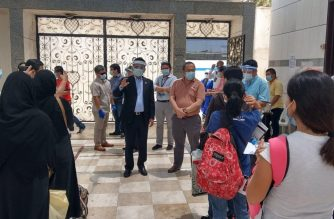 Philippine Consul General to Jeddah Edgar B. Badajos (center, in black suit) briefs the repatriates prior to their departure for the King Abdulaziz International Airport. He is accompanied by Labor Attaché in Jeddah Nasser Munder (center, right). /PHL Consulate General in Jeddah/