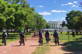 "Police form in front of the White House during a demonstration held on the afternoon of June 1, 2020. Protestors encouraged police officers to ""take a knee"" in support of ending racism and police brutality. (Photo by Dexter T. Manglicmot, Eagle News Service)"
