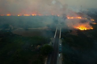 """Handout picture released by Mato Grosso do Sul State Government showing an aerial view of a massive forest fire at the Pantanal ecoregion of Brazil, municipality of Corumba, Mato Grosso do Sul state, on October 29, 2019. - Massive fire of """"proportions never before recorded"""" are devastating three municipalities in the Pantanal region in southern Brazil, the state government Mato Grosso do Sul reported Thursday, describing the situation as """"critical"""". (Photo by Chico Ribeiro / Mato Grosso do Sul State Government / AFP) / RESTRICTED TO EDITORIAL USE - MANDATORY CREDIT """"AFP PHOTO / Mato Grosso do Sul State Government  / Chico RIBEIRO """" - NO MARKETING - NO ADVERTISING CAMPAIGNS - DISTRIBUTED AS A SERVICE TO CLIENTS"""