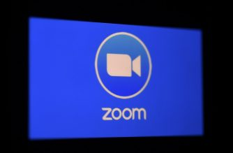 In this photo illustration a Zoom App logo is displayed on a smartphone on March 30, 2020 in Arlington, Virginia. - The Zoom video meeting and chat app has become the wildly popular host to millions of people working and studying from home during the coronavirus outbreak. (Photo by Olivier DOULIERY / AFP)