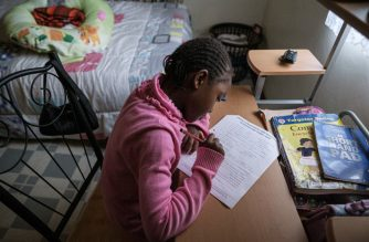 Eliana Wamuyu, 8, works on an environment and Christian religion exam at her grand mother's home to use the internet as her school has been closed due to the novel coronavirus COVID-19, in Nairobi, on April 29, 2020. (Photo by Yasuyoshi CHIBA / AFP)