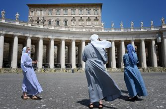 Nuns attend Pope Francis' live streamed Angelus prayer on Saint Peter's square on May 24, 2020 at the Vatican. (Photo by Alberto PIZZOLI / AFP)