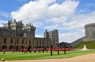 Guardsmen keep social distance as they stand in formation for a ceremony to mark Britain's Queen Elizabeth II official birthday, at Windsor Castle in Windsor, southeast England on June 13, 2020, as Britain's Queen Elizabeth II celebrates her 94th birthday this year. (Photo by TOBY MELVILLE / POOL / AFP)