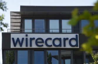 "The company logo is seen at the headquarters of German payments provider Wirecard in Aschheim near Munich, southern Germany, on June 24, 2020. - In what could be one of the biggest financial frauds of recent years, German payments provider Wirecard admitted 1.9 billion euros that auditors say are missing from its accounts likely ""do not exist"". (Photo by Christof STACHE / AFP)"