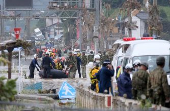 Residents are evacuated from flood-affected area by rubber boats in Kuma village, Kumamoto prefecture, on July 5, 2020. - At least 16 people are dead after torrential rain in Japan triggered massive floods and mudslides, local media said,  as rescue workers sift through debris in search of a dozen missing. (Photo by STR / JIJI PRESS / AFP) / Japan OUT