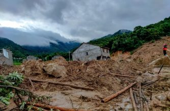 This photo taken on July 8, 2020 shows debris at the scene of a landslide in Huangmei county, Huanggang city, in China's central Hubei province. - Heavy rains and landslides in China have left at least 14 people dead or missing over the past day, burying houses and causing scenic areas to temporarily shut. (Photo by STR / AFP) / China OUT