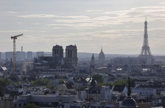 A picture taken in Paris, on July 9, 2020, shows Notre Dame Church, the Eiffel Tower and roofs of Paris. -  (Photo by Thomas SAMSON / AFP)