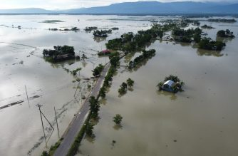 In this aerial photo inundated houses are seen in Sunamgong on July 14, 2020. - Almost four million people have been hit by monsoon floods in South Asia, officials said July 14, with a third of Bangladesh already underwater from some of the heaviest rains in a decade. (Photo by Munir UZ ZAMAN / AFP)