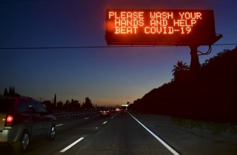 A sign on a Los Angeles freeway reminds people to wash their hands to help beat COVID-19 on July 14, 2020 in Los Angeles, California. - California's Governor Gavin Newsom announced a significant rollback of the state's reopening plan on July 13, 2020 as coronavirus cases soared across America's richest and most populous state. (Photo by Frederic J. BROWN / AFP)