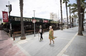 Tourists walk at Calle de la Cerveza (Bierstrasse) in Palma de Mallorca, at Spain's Balearic island of Majorca on July 16, 2020. - Regional authorities on Spain's Balearic island of Majorca ordered the immediate closure of bars on three streets popular with hard drinking tourists to limit the potential for coronavirus outbreaks. (Photo by JAIME REINA / AFP)