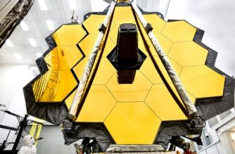 """(FILES) This file NASA handout released on May 16, 2017 shows the primary mirror of NASA's James Webb Space Telescope inside a cleanroom at NASA's Johnson Space Center in Houston, Texas. - NASA on July 16, 2020 postponed the launch of its $10 billion James Webb Space Telescope from March next year to October 31, 2021, blaming the pandemic and other technical challenges. (Photo by Chris GUNN / NASA / AFP) / RESTRICTED TO EDITORIAL USE - MANDATORY CREDIT """"AFP PHOTO / NASA/CHRIS GUNN"""" - NO MARKETING NO ADVERTISING CAMPAIGNS - DISTRIBUTED AS A SERVICE TO CLIENTS"""