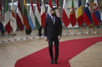 Spain's Prime Minister Pedro Sanchez, wearing a protective face mask, arrives for a European Union Council in Brussels on July 17, 2020, as the leaders of the European Union hold their first face-to-face summit over a post-virus economic rescue plan. - The EU has been plunged into a historic economic crunch by the coronavirus crisis, and EU officials have drawn up plans for a huge stimulus package to lead their countries out of lockdown. (Photo by Francisco Seco / POOL / AFP)