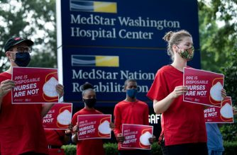 Nurses and their supporters protest demanding better Personal Protective Equipment outside MedStar's Washington Hospital Center on July 23, 2020, in Washington, DC. (Photo by Brendan Smialowski / AFP)