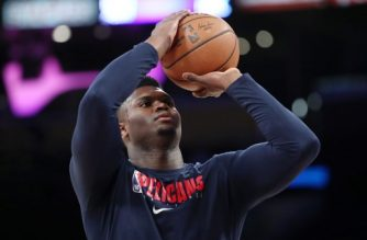 (FILES) In this file photo taken on February 24, 2020 Zion Williamson #1 of the New Orleans Pelicans warms up before the game against the Los Angeles Lakers at Staples Center in Los Angeles, California. - New Orleans Pelicans rookie star Zion Williamson has returned to the NBA's quarantine bubble, but might not be in fit condition for the team's NBA restart opener Thursday. Williamson was spending his first full day back in in-room isolation Saturday after leaving the Walt Disney World campus July 16 to deal with a family emergency and returning Friday night. (Photo by Katelyn Mulcahy / GETTY IMAGES NORTH AMERICA / AFP)