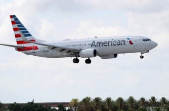 FORT LAUDERDALE, FLORIDA - JULY 16: An American Airlines plane prepares to land at the Fort Lauderdale-Hollywood International Airport on July 16, 2020 in Fort Lauderdale, Florida. JetBlue Airways and American Airlines Group announced they will be creating an alliance between the two companies.   Joe Raedle/Getty Images/AFP
