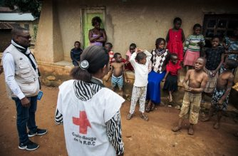 Members of the International Federation of the Red Cross and the Congolese Red Cross go door-to-door in the Beni neighbourhoods, northeastern Democratic Republic of Congo, to listen to families about their fear of the Ebola virus and the response teams on August 31, 2019. - The Ebola outbreak, declared in August 2018, have killed more than 2,000 people in DR Congo and Uganda. (Photo by ALEXIS HUGUET / AFP)