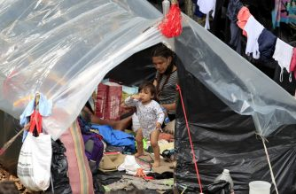 A child walks at a makeshift camp where jobless and homeless Venezuelan migrants remain during the COVID-19 cooronavirus pandemic in Bogota, on June 16, 2020. - Venezuelan President Nicolas Maduro announced  last week restrictions for Venezuelans wanting to return to their country from Colombia, limiting the returnees to 300 people per week. (Photo by DANIEL MUNOZ / AFP)
