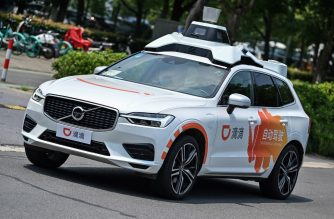 "This photo taken on July 22, 2020 shows a Didi Chuxing autonomous taxi during a pilot test drive on the streets in Shanghai. - Chinese entrants in the race to put autonomous vehicles on the road are bringing ""robotaxis"" online in hopes that a hired-car format can be the key to unlocking wide acceptance of the futuristic technology. (Photo by Hector RETAMAL / AFP) / TO GO WITH AFP STORY IT-China-automobile-autonomous-computers,FOCUS by Beiyi Seow and Dan Martin"