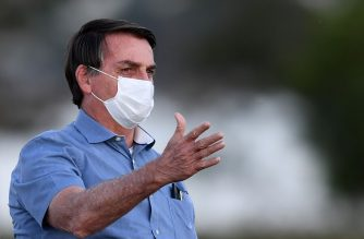 Brazilian President Jair Bolsonaro gestures as he speaks to supporters in the garden of the Alvorada Palace in Brasilia, on July 24, 2020. (Photo by EVARISTO SA / AFP)