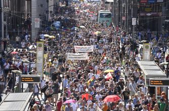 "People attend a demonstration initiated by the initiative ""Querdenken-711"" with the slogan ""the end of the pandemic-the day of freedom"" to protest against the current measurements to curb the COVID-19 spreading in Berlin, on August 1, 2020. (Photo by John MACDOUGALL / AFP)"