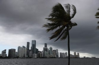 (FILES) In this file photo taken on August 01, 2020 storm clouds are seen over the city as Hurricane Isaias approaches the east coast of Florida in Miami, Florida. - Isaias roared closer to the Florida coast August 2, 2020, threatening to bring strong winds, flash flooding and storm surges but no longer expected to regain hurricane strength. Tropical storm Isaias, downgraded from a category 1 hurricane, was packing sustained winds of 65 miles (105 kilometers) per hour on Sunday afternoon, the National Hurricane Center (NHC) said. (Photo by JOE RAEDLE / GETTY IMAGES NORTH AMERICA / AFP)