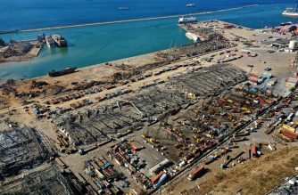 An aerial view shows the massive damage done to Beirut port's grain silos (C) and the area around it on August 5, 2020, one day after a mega-blast tore through the harbour in the heart of the Lebanese capital with the force of an earthquake, killing more than 100 people and injuring over 4,000. - Rescuers searched for survivors in Beirut in the morning after a cataclysmic explosion at the port sowed devastation across entire neighbourhoods, killing more than 100 people, wounding thousands and plunging Lebanon deeper into crisis. (Photo by - / AFP)