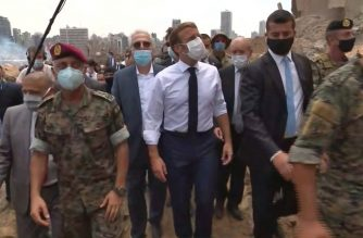 A video grab shows French President Emmmanuel Macron (C) inspecting the damages at the port of Lebanon's capital Beirut, on August 6, 2020, where a massive explosion killed more than 100 people and devastated the city. (Photo by - / POOL / AFP)