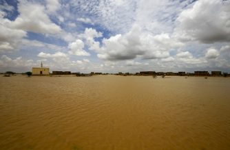 A picture shows a flooded area, as a result of torrential rain, in the town of Osaylat, 50 km southeast of the capital Khartoum, on August 6, 2020, (Photo by ASHRAF SHAZLY / AFP)