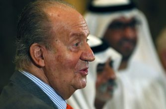 (FILES) In this file photo taken on April 14, 2014 Spain's King Juan Carlos greets UAE's officials as he arrives for a session of the first UAE-Spain Economic Forum at the Emirates Palace hotel in Abu Dhabi. - The Spanish king emeritus Juan Carlos I, who went into exile persecuted by a corruption scandal two weeks ago, is in the United Arab Emirates, the Royal House announced on August 17, 2020, clearing up the unknown about the whereabouts of the former head of state. (Photo by Karim SAHIB / AFP)