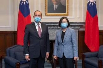 """This handout photo taken and released by the Taiwan Presidential Office on August 10, 2020 showing Taiwan's President Tsai Ing-wen (R) posing for photos with US Secretary of Health and Human Services Alex Azar (L) during his visit to the Presidential Office in Taipei. - The US cabinet member met Taiwan's leader on August 10 during the highest level visit from the United States since it switched diplomatic recognition from the island to China in 1979, a trip that Beijing has condemned. (Photo by Handout / Taiwan Presidential Office / AFP) / -----EDITORS NOTE --- RESTRICTED TO EDITORIAL USE - MANDATORY CREDIT """"AFP PHOTO / TAIWAN PRESIDENTIAL OFFICE"""" - NO MARKETING - NO ADVERTISING CAMPAIGNS - DISTRIBUTED AS A SERVICE TO CLIENTS"""