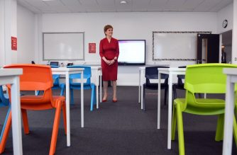 First Minister of Scotland Nicola Sturgeon views a classroom as she visits West Calder High School in West Calder, Scotland on August 10, 2020 to see preparations ahead of pupils returning later this week after a four-month shutdown to combat the spread of the novel coronavirus. - Scotland's schools will start reopening on August 11 after a more than four month long shutdown sparked by the global novel coronavirus pandemic. (Photo by Andy Buchanan / POOL / AFP)