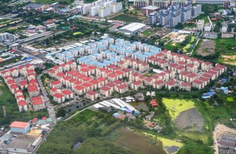 This aerial photograph taken on August 1, 2020 shows apartment buildings in the outskirts of Bangkok. (Photo by Mladen ANTONOV / AFP)