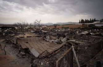 A general view shows a burnt holiday park in Mollina near Malaga on August 10, 2020. - A wind-fuelled fire ripped through a holiday park in Spain that is home to a large number of British pensioners, destroying dozens of homes and injuring two people, officials said. (Photo by JORGE GUERRERO / AFP)