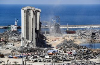 Diggers remove earth at the blast site next to the silos at the port of Beirut on August 16, 2020, in the aftermath of the massive explosion there that ravaged Lebanon's capital. (Photo by ANWAR AMRO / AFP)