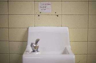 (FILES) In this file photo a placard posted above a water fountain warns against drinking the water at Flint Northwestern High School in Flint, Michigan, May 4, 2016, where US President Barack Obama met with locals for a neighborhood roundtable on the drinking water crisis. - The US state of Michigan has agreed to pay some $600 million to victims of the Flint water crisis, a health scandal that became a symbol of social injustice in America, reports said on August 20, 2020. At least 12 people died after the decaying industrial city switched its drinking water source to the polluted Flint River to cut costs in 2014. However, officials failed to add corrosion controls to the new tap water source, allowing lead and other contaminants to leach from the city's aging pipe system, the New York Times and Washington Post reported. (Photo by Jim Watson / AFP)