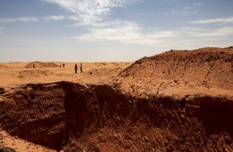 A vast trench dug by gold hunters is pictured at the devastated two millenia-old site of Jabal Maragha, in the desert of Bayouda, some 270 kms (170 miles) north of the Sudanese capital Khartoum on August 20, 2020. - The site, dating from the Meroic period from 350 BC to 350 AD, was either a small settlement or a checkpoint. After the diggers, hardly anything remains. The destruction of ancient sites is an added tragedy for a country long riven by civil war between rival ethnic groups, destroying a common cultural identity of a nation. (Photo by Ebrahim HAMID / AFP)
