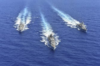 """A handout photo released by the Greek National Defence Ministry on August 26, 2020 shows ships of the Hellenic Navy taking part in a military exercise in the eastern Mediterranean Sea, on August 25, 2020. - Greece said it will launch military exercises on August 25 with France, Italy and Cyprus in the eastern Mediterranean, the focus of escalating tensions between Athens and Ankara. The joint exercises south of Cyprus and the Greek island of Crete will last three days, the defence ministry said. The discovery of major gas deposits in waters surrounding Crete and Cyprus has triggered a scramble for energy riches and revived old rivalries between NATO members Greece and Turkey. (Photo by Handout / GREEK DEFENCE MINISTRY / AFP) / RESTRICTED TO EDITORIAL USE - MANDATORY CREDIT """"AFP PHOTO / GREEK DEFENCE MINISTRY"""" - NO MARKETING - NO ADVERTISING CAMPAIGNS - DISTRIBUTED AS A SERVICE TO CLIENTS"""