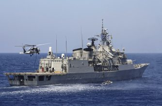 """A handout photo released by the Greek National Defence Ministry on August 26, 2020 shows Greek Hydra-class frigate Psara (F-454) of the Hellenic Navy and a military helicopter taking part in a military exercise in the eastern Mediterranean Sea, on August 25, 2020. - Greece said it will launch military exercises on August 25 with France, Italy and Cyprus in the eastern Mediterranean, the focus of escalating tensions between Athens and Ankara. The joint exercises south of Cyprus and the Greek island of Crete will last three days, the defence ministry said. The discovery of major gas deposits in waters surrounding Crete and Cyprus has triggered a scramble for energy riches and revived old rivalries between NATO members Greece and Turkey. (Photo by Handout / GREEK DEFENCE MINISTRY / AFP) / RESTRICTED TO EDITORIAL USE - MANDATORY CREDIT """"AFP PHOTO / GREEK DEFENCE MINISTRY"""" - NO MARKETING - NO ADVERTISING CAMPAIGNS - DISTRIBUTED AS A SERVICE TO CLIENTS"""