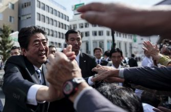(FILES) This file photo taken on October 18, 2017 shows Japan's Prime Minister and ruling Liberal Democratic Party (LDP) president Shinzo Abe (L) greeting his supporters during an election campaign appearance in Saitama. - Japan's Prime Minister Shinzo Abe is to resign over health problems, local media reported on August 28, 2020, in a bombshell development that will end a record-setting tenure with no clear successor yet in place. (Photo by Behrouz MEHRI / AFP)